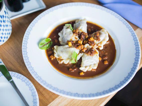Gravy and potatos on a plate